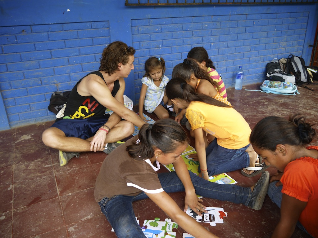 Co founder Matt Wilson putting together puzzles with children from a local school