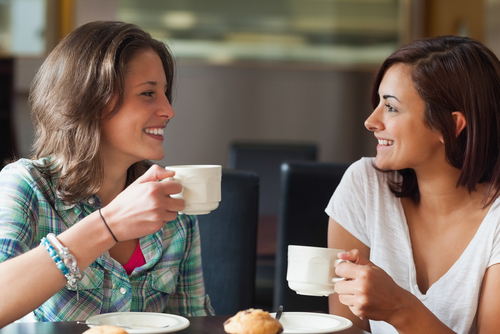 Two women chatting over coffee